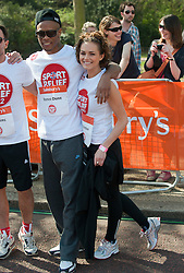 Rapper Romeo Dunn and  Kara Tointon  taking part in a one mile run for Sport Relief charity in London, 25th March 2012.  Photo by: i-Images
