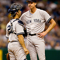 New York Yankees catcher Jorge Posada, left, talks with pitcher Randy Johnson during the fifth inning of their American League baseball game against the Tampa Bay Devil Rays on Thursday, May 4, 2006 in St. Petersburg, Fla.(AP Photo/Scott Audette)