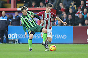 Dannie Bulman of AFC Wimbledon and Danny Butterfield of Exeter City tussles during the Sky Bet League 2 match between Exeter City and AFC Wimbledon at St James' Park, Exeter, England on 28 December 2015. Photo by Stuart Butcher.