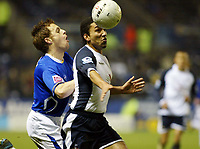 Photo: Chris Ratcliffe.<br /> Leicester City v Tottenham Hotspur. The FA Cup.<br /> 08/01/2006.<br /> Aaron Lennon (R) of Spurs battles with Alan Maybury