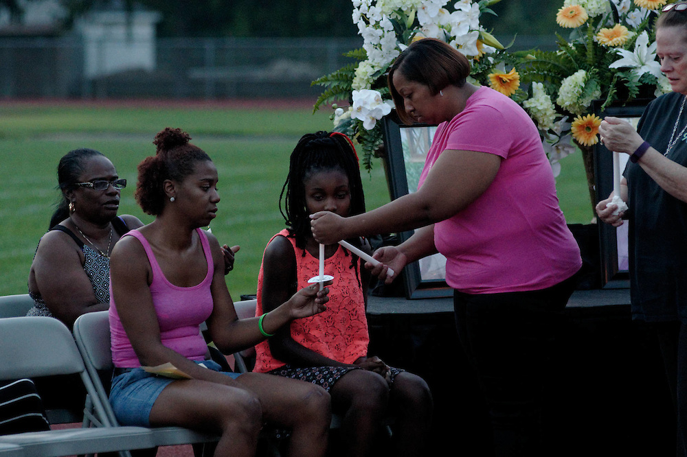 Family, friends, students, district employees and residents gather at a vigil to honor the lives of Janiya Castleberry and Allison McGinnis, at Helen Fort/Newcomb Middle School in Pemberton, NJ, on Thursday September 3, 2015.