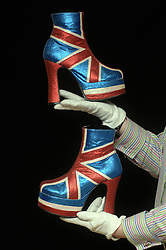 (C) London News Pictures 28/01/2011.The collection of Liz West the UKÕs leading Spice Girls merchandise and memorabilia collector is on display for the first time ever to the public at Leeds City Museum.   Helen Langwick, curator of Exhibitions at the museum with a pair of Geri Halliwell's iconic Union Jack boots..Sam Atkins/London News Pictures