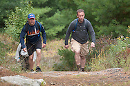 Kerhonkson, New York - Hikers move through Minnewaska State Park Preserve during the Shawangunk Ridge Trail Run/Hike 20-mile race on Sept. 20, 2014.
