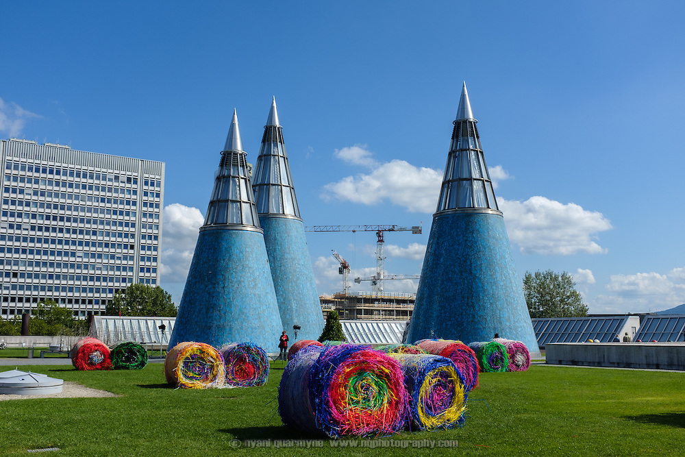 "Michael Beutler's ""Bale Harvest"" aginst the backdrop of the cones on the roof of the Bundeskunsthalle museum as part of an exhibition entitled ""Trouble in Paradise"" in Dusseldorf, Germany on 10 September 2015."