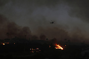 San Marcos, California, U.S. - <br /> <br /> California Wildfires 2014 - Cocos Fire<br /> <br /> A water dropping helicopter makes a drop near a home while battling the Cocos fire near Cal State San Marcos on Wednesday, May 14, 2014 in San Diego County, Calif. The fire in San Marcos burned out of control Wednesday, destroying houses and forcing nearby residents from their homes. The fire burned at least three homes and one structure near Cal State San Marcos. <br /> ©Exclusivepix