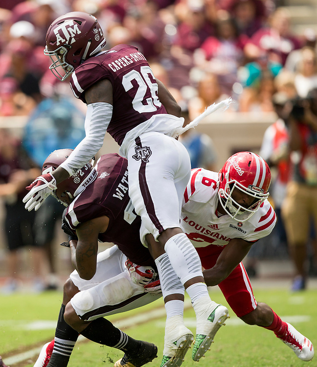 Texas A&M defensive back Armani Watts (23) intercepts a pass in front of Louisiana-Lafayette wide receiver Michael Jacquet (6) during the third quarter of an NCAA college football game Saturday, Sept. 16, 2017, in College Station, Texas. (AP Photo/Sam Craft)
