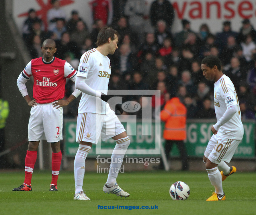 Picture by Mike  Griffiths/Focus Images Ltd +44 7766 223933.16/03/2013.Michu (l) and Jonathan de Guzman (r) kick off for Swansea City against Arsenal during the Barclays Premier League match at the Liberty Stadium, Swansea.