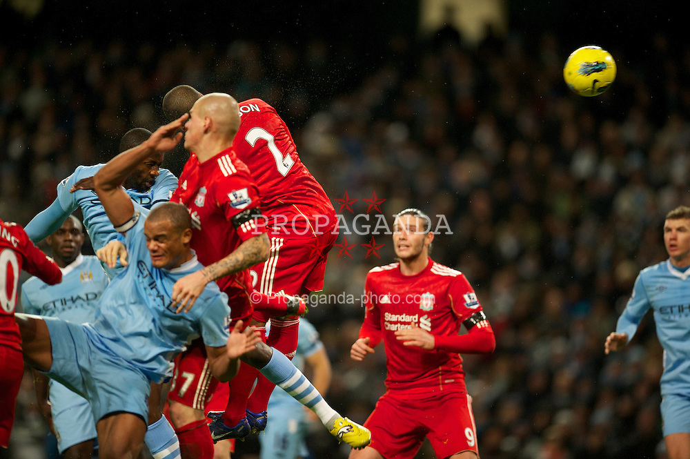 MANCHESTER, ENGLAND - Tuesday, January 3, 2012: Manchester City's Yaya Toure scores the second goal against Liverpool during the Premiership match at the City of Manchester Stadium. (Pic by David Rawcliffe/Propaganda)