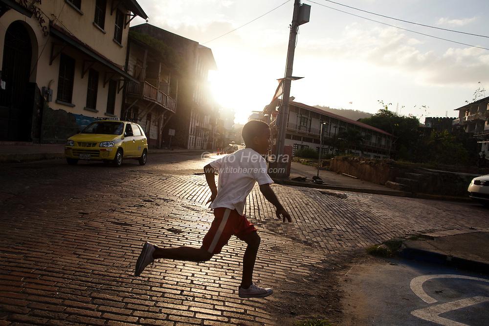 "Boy runs across the streets of Plaza Herrera  in San Felipe,  the Colonial side of Panama City also call ""Casco Viejo"" Photo by Tito Herrera"