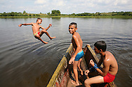 kids playing at a lake in Colombia