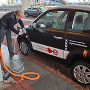 Nederland, Amsterdam, 26-10-2009  Electric car plugged into a charge point parked  in front of the conference building where the Club of Rome Global Assembly 2009 takes place . Foto: Gerard Til / Hollandse Hoogte