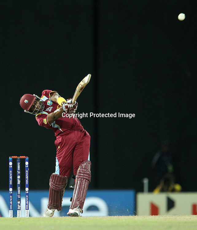 Dwayne Bravo of The West Indies during the ICC World Twenty20 semi final match between Australia and The West Indies held at the Premadasa Stadium in Colombo, Sri Lanka on the 5th October 2012<br /> <br /> Photo by Ron Gaunt/SPORTZPICS