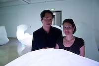 Synthetic Times exhibition at NAMOC, Beijing, China. Jeffrey Huang(L) designer, architect and director of the Media and Design Laboratory photographed with Muriel Waldvogel visual designer and architect. Together they run Convergeo.com. Photographed in Beijing during Synthetic Times exhibition.