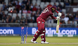 West Indies Sheldon Cottrell is bowled by New Zealand's Lockie Ferguson during the ICC Cricket World Cup group stage match at Old Trafford, Manchester.