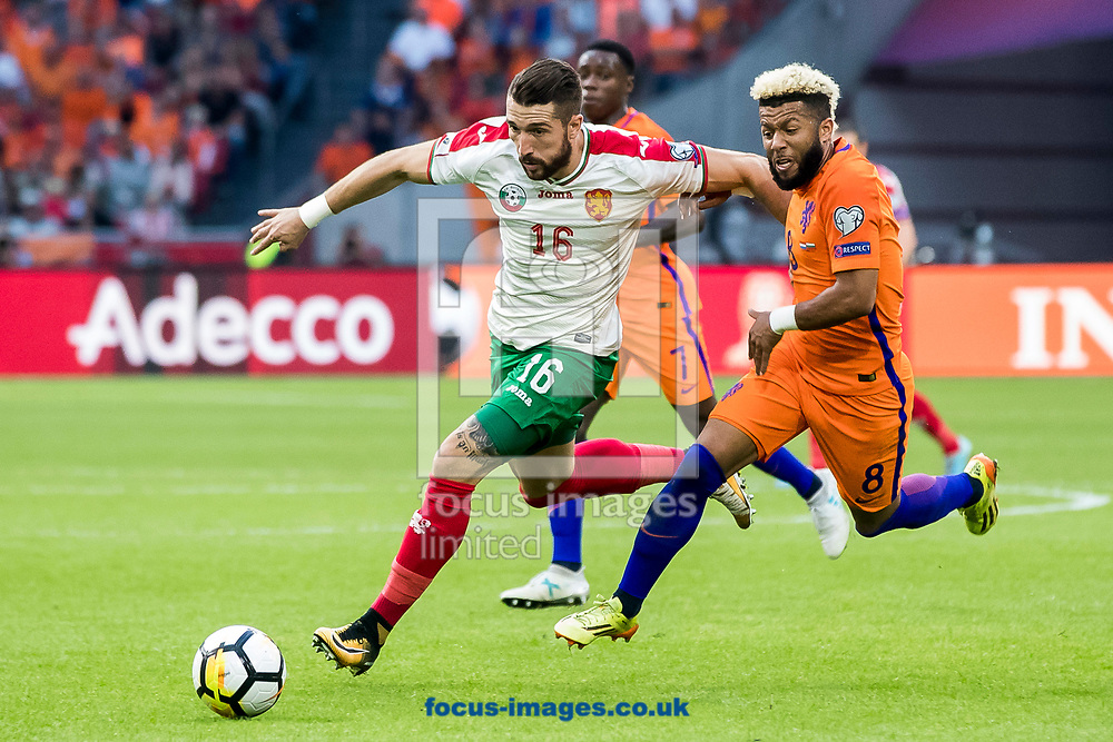 Andrej Galabinov of Bulgaria (L), Tonny Vilhena of Netherlands (R) during the 2018 FIFA World Cup Qualifying match at Amsterdam Arena, Amsterdam<br /> Picture by Joep Joseph Leenen/Focus Images Ltd +316 5261929<br /> 03/09/2017<br /> ***NETHERLANDS OUT***