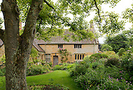 The 15th century manor house surrounded by cottage style borders at East Lambrook Manor Gardens, South Petherton, Ilminster, Somerset, UK