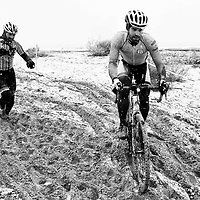 Cyclocross riders navigate the sand during a snowstorm at the Illinois Cyclocross Championships in Chicago