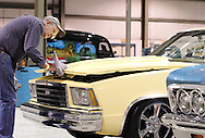 Larry Goolman of Centerville helps wife Vickie get her 79 Chevy Malibu ready for the crowds during the KOI Hot Rod Fest Dayton at the Dayton Airport Expo Center in Vandalia, Sunday, March 12, 2012.