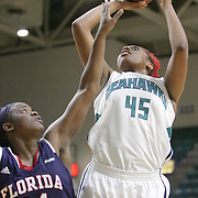 UNCW's Ryan Flowers shoots over Florida Atlantic's Shanequa Schrouder. (Jason A. Frizzelle)