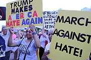 Anti-white supremacy rotesters hold anti hate signs during the Anti Racism Rally in front of City hall in downtown Dallas on Saturday August 19, 2017.