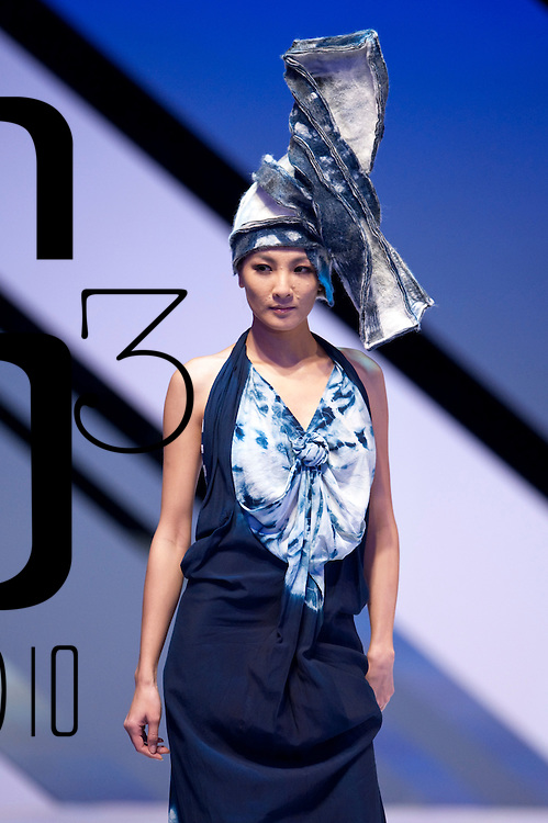 HONG KONG - JANUARY 18:  A model showcases designs by Minono on the catwalk during the Taiwan Textile Federation show as part of the  Hong Kong Fashion Week Fall/Winter 2010 on January 18, 2010 in Hong Kong.  Photo by Victor Fraile / studioEAST