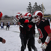 New Canaan players celebrate a touchdown during the New Canaan Rams Vs Darien Blue Wave, CIAC Football Championship Class L Final at Boyle Stadium, Stamford. The New Canaan Rams won the match in snowy conditions 44-12. Stamford,  Connecticut, USA. 14th December 2013. Photo Tim Clayton