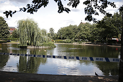 © Licensed to London News Pictures. 13/08/2019. London, UK. A pond in Feltham Green in south west London remains cordoned off after the discovery of a body. A man thought to be aged 54 was pronounced dead at the scene at 10: 15.  Photo credit: Peter Macdiarmid/LNP
