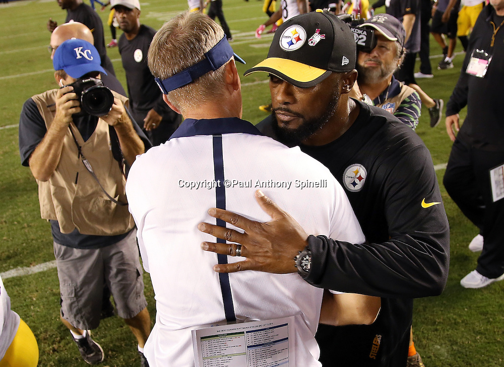 Pittsburgh Steelers head coach Mike Tomlin (right) gets a postgame congratulatory hug from San Diego Chargers head coach Mike McCoy after the 2015 NFL week 5 regular season football game against the San Diego Chargers on Monday, Oct. 12, 2015 in San Diego. The Steelers won the game 24-20. (©Paul Anthony Spinelli)