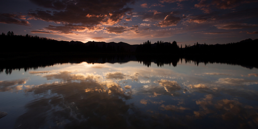 Reflections of a perfect summer morning on Little Molas Lake in the Colorado Rockies, CO