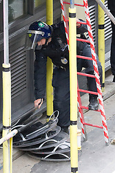 © Licensed to London News Pictures . 11/06/2013 . London , UK . Police stack up riot shields by an adjoining property . Police surround a former police station on 40 Beak Street , Soho this morning (11th June) . The site has been occupied by organisers of today's Stop G8 anti capitalist protests . Demonstrations in London today (Tuesday 11th June 2013) ahead of Britain hosting the 39th G8 summit on 17th/18th June at the Lough Erne Resort , County Fermanagh , Northern Ireland , next week . Photo credit : Joel Goodman/LNP