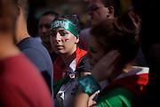 Mainz | 18 July 2014<br /> <br /> Am Samstag (18.07.2014) nahmen etwa 1000 M&auml;nner, Frauen und Kinder in der Innenstadt von Mainz anl&auml;sslich der milit&auml;rischen Auseinandersetzung zwischen Israel und der Hamas in Gaza an einer Solidarit&auml;tsdemonstration f&uuml;r Gaza, ein freies Pal&auml;stina und gegen Israel teil. Bei der Demo wurden Fahnen der Hamas und der Hisbollah mitgef&uuml;hrt, neben den &uuml;blichen Parolen gegen Israel wurde in Sprechch&ouml;hren auch vereinzelt zur Vernichtung von J&uuml;dinnen und Juden aufgerufen.<br /> Hier: Eine junge Frau mit Djihadisten-Stirnband hat sich die pal&auml;stinensische Fahne auf die Wange gemalt.<br /> <br /> <br /> &copy;peter-juelich.com<br /> <br /> [No Model Release | No Property Release]