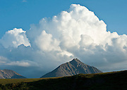 Cumulus cloud build up over a peak in the Brooks Range, Arctic National Wildlife Refuge, Alaska