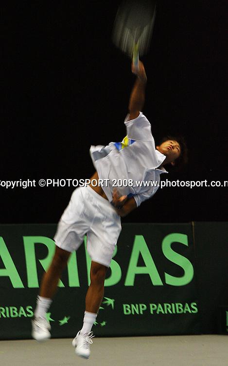 Yan Bai serves to Daniel King-Turner.<br /> Davis Cup Tennis singles, final day - New Zealand v China at TSB Stadium, New Plymouth, New Zealand. Sunday, 21 September 2008. Photo: Dave Lintott/PHOTOSPORT