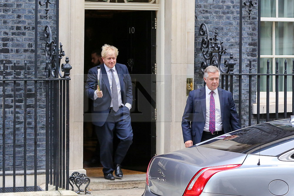 "© Licensed to London News Pictures. 23/10/2019. London, UK. British Prime Minister BORIS JOHNSON departs from Number 10 Downing Street to attend Prime Minister's Questions (PMQs) in the House of Commons. On Tuesday 22 October 2019, MPs rejected Prime Minister BORIS JOHNSON'S fast-track timetable for ratifying the Brexit deal and the government ""paused"" the parliamentary process — almost certainly ending any prospect of Brexit on 31 October.  Photo credit: Dinendra Haria/LNP"