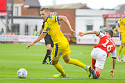 Joe Pigott of AFC Wimbledon (39) and Jordan Rossiter of Fleetwood Town (16) in action during the EFL Sky Bet League 1 match between Fleetwood Town and AFC Wimbledon at the Highbury Stadium, Fleetwood, England on 10 August 2019.