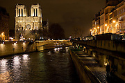 Cathedral Notre Dame de Paris at night on Île de la Cité by  the river Seine, Paris, France