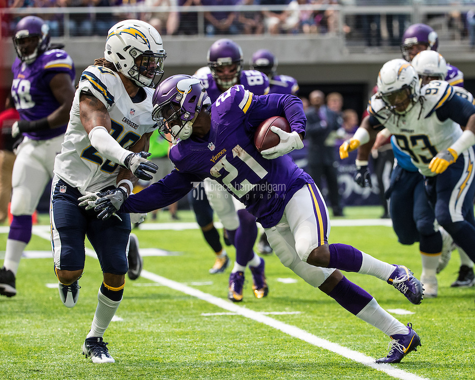 Aug 28, 2016; Minneapolis, MN, USA; Minnesota Vikings running back Jerick McKinnon (21) is tackled by San Diego Chargers safety Dwight Lowery (20) during a preseason game at U.S. Bank Stadium. The Vikings defeated the Chargers 23-10. Mandatory Credit: Brace Hemmelgarn-USA TODAY Sports
