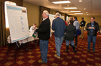 Tony Felch adds his ideas on the Community Values board during Re Imagine Laconia event at the Opechee Conference Center Wednesday evening.  (Karen Bobotas Photographer)
