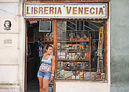 Woman standing in the door of a bookstore<br />