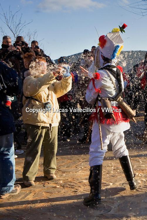 Botarga strip the fluff of reeds to the public. Carnival, Almiruete. Tamajon, Guadalajara province, Castilla-La Mancha, Spain