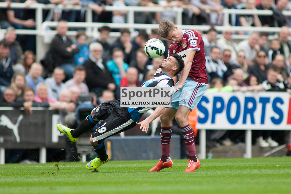Emmanuele Riviere (Newcastle) and Reece Burke (West Ham) in the Newcastle v West Ham, Barclays Premiership match at St James&rsquo; Park, Newcastle 24 May 2014<br />