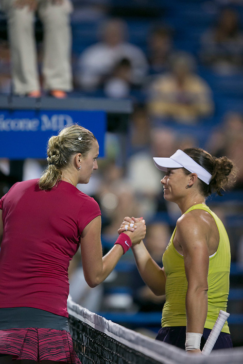 August 22, 2014, New Haven, CT:<br /> Petra Kvitova and Samantha Stosur shake hands at net after the semi-final match against Petra Kvitova on day eight of the 2014 Connecticut Open at the Yale University Tennis Center in New Haven, Connecticut Friday, August 22, 2014.<br /> (Photo by Billie Weiss/Connecticut Open)