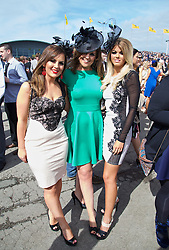 LIVERPOOL, ENGLAND - Friday, April 4, 2014: Jessica Wiggins wearing Lipsey, Amanda Coad wearing Ted Baker and Ashleigh Marvelley wearing Lipsey during Ladies' Day on Day Two of the Aintree Grand National Festival at Aintree Racecourse. (Pic by David Rawcliffe/Propaganda)