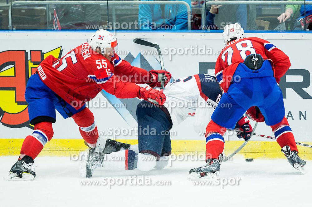 Mike Reilly of USA between Ole-Kristian Tollefsen of Norway and Niklas Roest of Norway  during Ice Hockey match between Norway and USA at Day 2 in Group B of 2015 IIHF World Championship, on May 2, 2015 in CEZ Arena, Ostrava, Czech Republic. Photo by Vid Ponikvar / Sportida