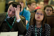 Rider Igett, left, and Lillian Nguyen, right, listen to another bee participant while waiting for their next turn during the Southeast Ohio Regional Spelling Bee Saturday, March 16, 2013. The Regional Spelling Bee was sponsored by Ohio University's Scripps College of Communication and held in Margaret M. Walter Hall on OU's main campus.