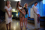 "Russian students learn to be ""real women"" under Vladimir Rakovsky, a self-proclaimed master of seduction. The course, given in Moscow, includes seduction theory, posture and strip-tease. The course, also dubbed ""How to Marry a Millionaire"", teaches women to be subservient to men. .The course takes place at the Dubrovka Theatre, scene of the terrorist siege."