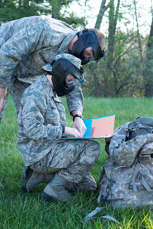 "Cadet Swan, heading the blue team, reviews the groups ""top secret"" materials with CAdet Nunnelley for their mission minutes before their mobile exercise begins on April 16, 2016. Photo by Ohio University / Kaitlynn Stone"