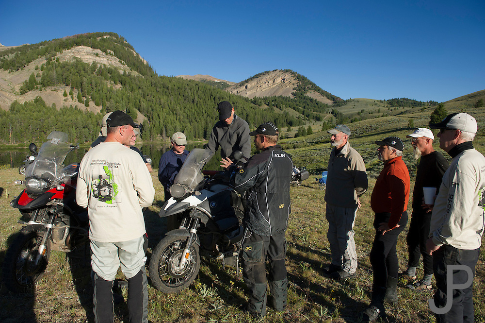 Riders gather around while 2010 BMW GS Trophy competitor Shannon Markle gives riding tips.