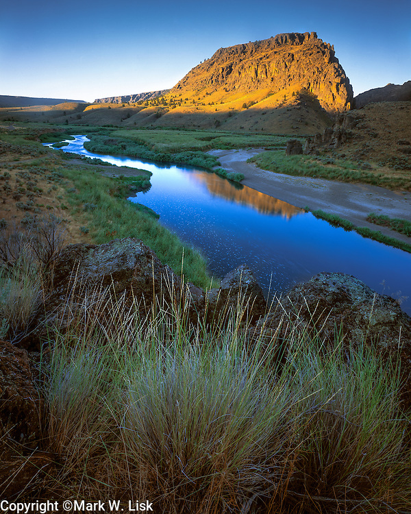 Sunrise hits the basalt peaks and buttes of the Owyhee Canyon Lands at the Three Forks confluence.