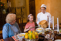South America, Ecuador, Latacunga, Hacienda San Agustin de Callo, waitress serving soup.  PR, MR